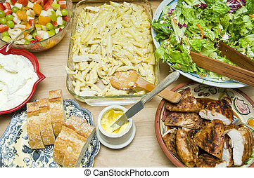 A variety of food on a table, absolutely delicious.