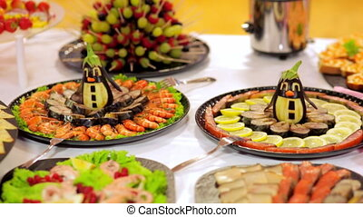 buffet: salads, meat and fish dishes are on the table