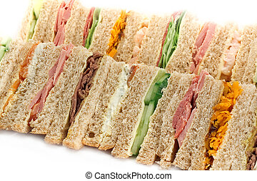 Buffet sandwich platter - Rows of sandwiches made with ...