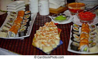 buffet, sushi and rolls on the plate