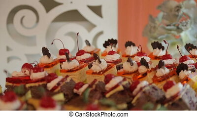 Buffet table, cake with cherries