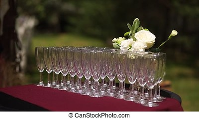 Buffet table with empty champagne glasses. Standing in the street.