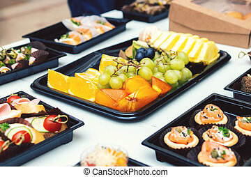 Buffet table with fruits and various kind of food. Business meeting.