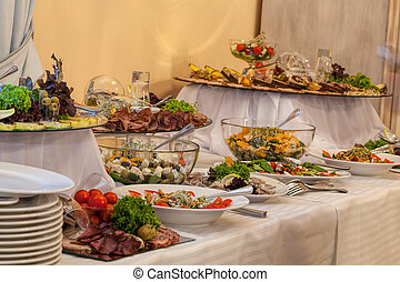 Buffet with different gourmet appetizers for wedding party