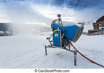 Bug snow gun making artificial snow at cold day - Bug blue...