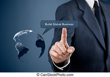 Build global business concept. Planet Earth and man click on...