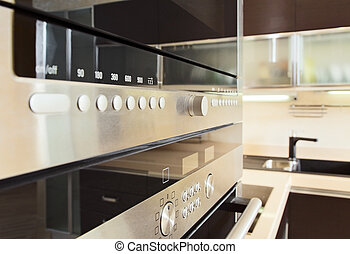 Build in microwave oven in modern kitchen interior with hardwood furniture