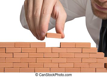 Build new business - Concept of businessman that builds a ...