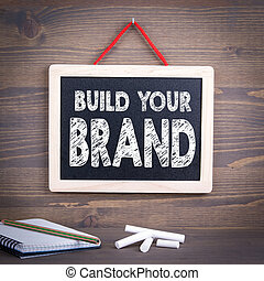 build your brand concept. Chalkboard on a wooden background