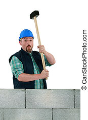 Builder about to smash wall
