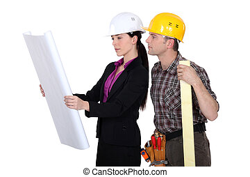 Builder and architect discussing plans