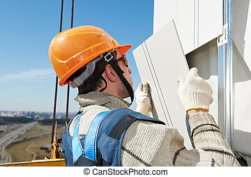 builder at aerated facade tile installation - worker ...