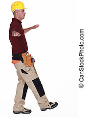Builder balancing on one leg