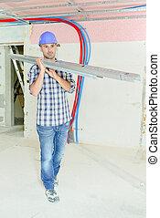 Builder carrying metal joists