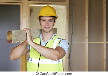 Builder Carrying Timer On Building Site