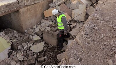 Builder checking building ruins