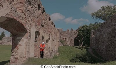 Builder checking the ruins of an old castle