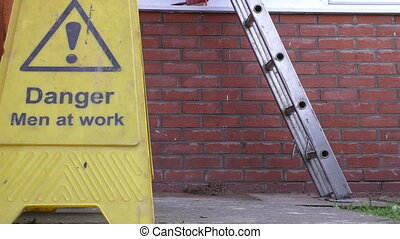 Builder climbing down the ladder - Building site worker...