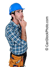Builder deep in thought