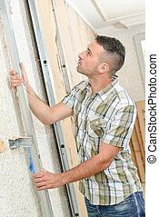 Builder erecting a metal frame