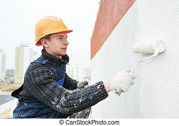 builder facade painter at work