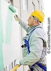 builder facade painter at work - builder worker painting ...