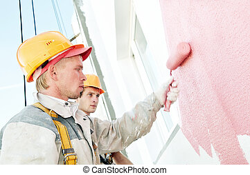builder facade painter worker - Young smiling painting ...