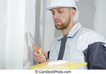 builder filling the wall