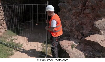 Builder fixing the fence