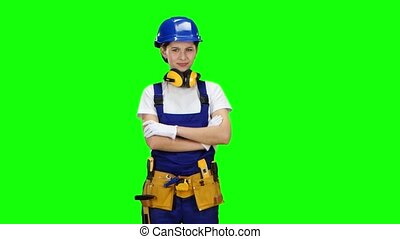 Construction worker girl in helmet showing finger down and saddened. Green screen