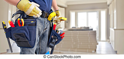 Builder handyman with construction tools. House renovation ...
