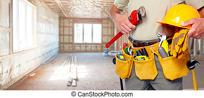 Builder handyman with construction tools. House renovation...