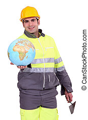 Builder holding a globe