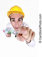 Builder holding cash