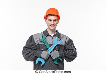 builder holding wrench isolated on white