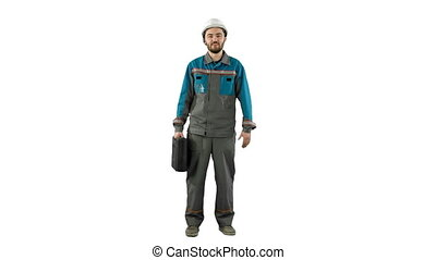 Builder in helmet with a suitcase says on camera on white background.