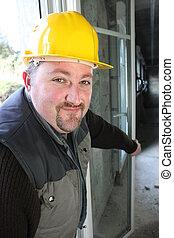 Builder installing double glazing