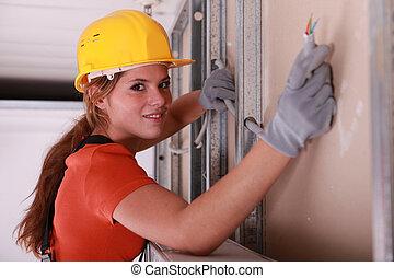 Builder installing electrical wiring