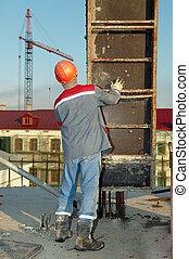 Builder installing formwork