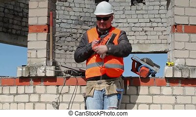 Builder keep tooling near to the unfinished building