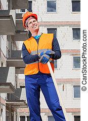 Builder keeping a spade