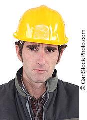 Builder looking upset