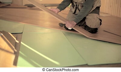 Builder man Install Laminate Floor - Builders man Install in...