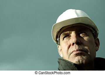 man with white hard hat, special photo toned f/x, focus point on the eye