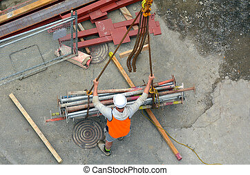 Builder manages the construction process of crane hook lifting work