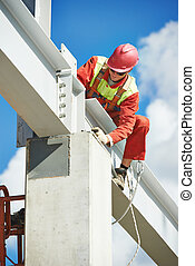 builder millwright worker at construction site - worker...