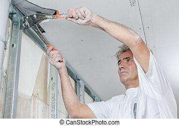 Builder mounting a metal frame