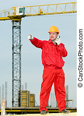 builder operating the tower crane - builder worker in...
