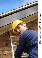 Builder or roofer climbing a ladder - A friendly builder...