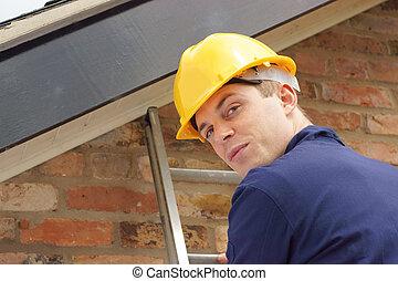 Builder or roofer on a ladder - A builder or roofer climbing...